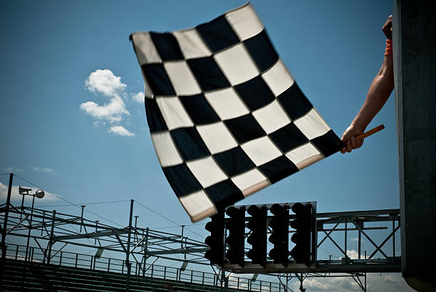 waving checkered flag - finishing stock photos and pictures