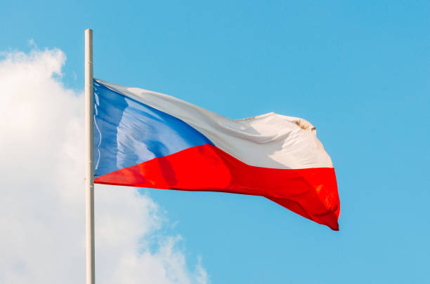 Waving colorful Czech Republic flag on blue sky Waving colorful Czech Republic flag on blue sky bohemia czech republic stock pictures, royalty-free photos & images