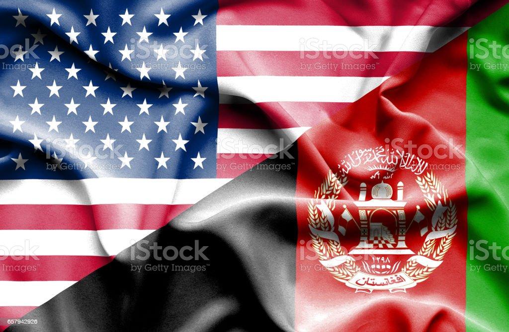 Waving flag of Afghanistan and USA stock photo