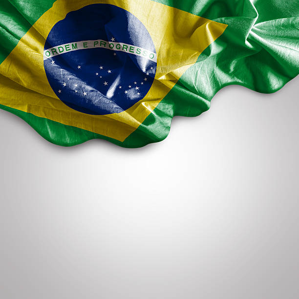 Waving flag of Brazil, South America stock photo