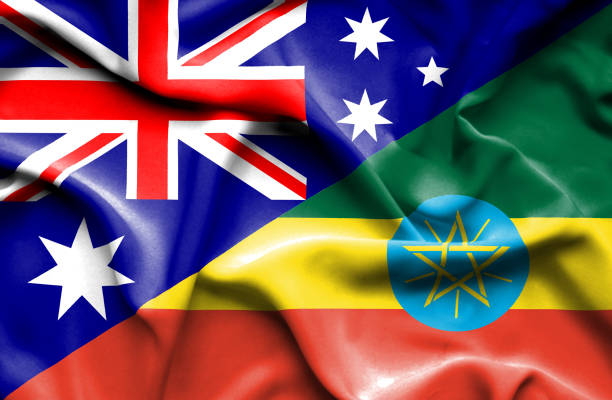 waving flag of ethiopia and australia - ethiopian flag stock photos and pictures
