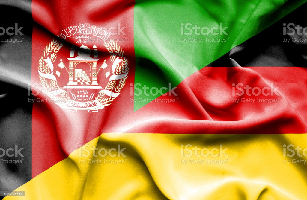 Waving flag of Germany and Afghanistan stock photo