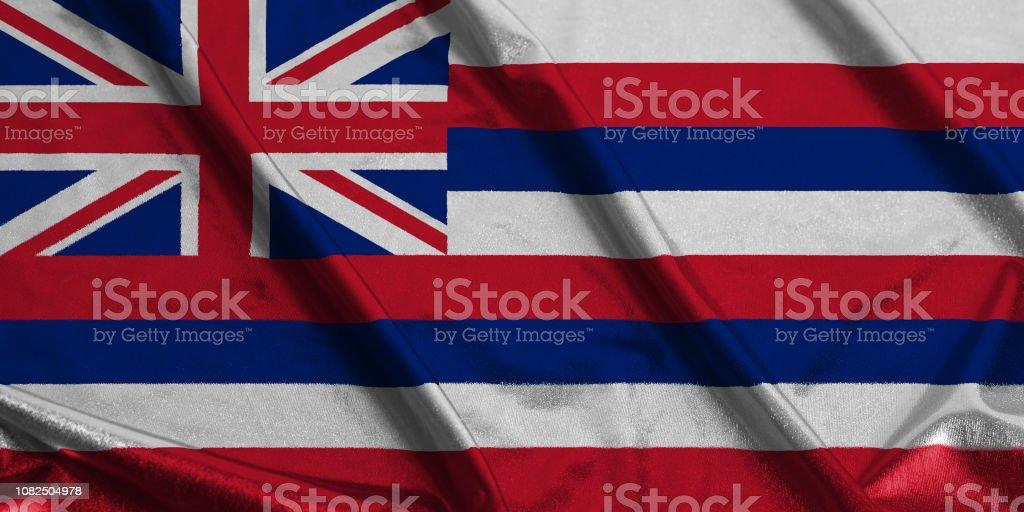 Acenando a bandeira da bandeira do estado americano de Havaí - foto de acervo
