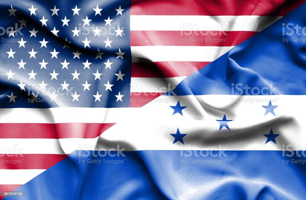 Waving flag of Honduras and USA royalty-free stock photo