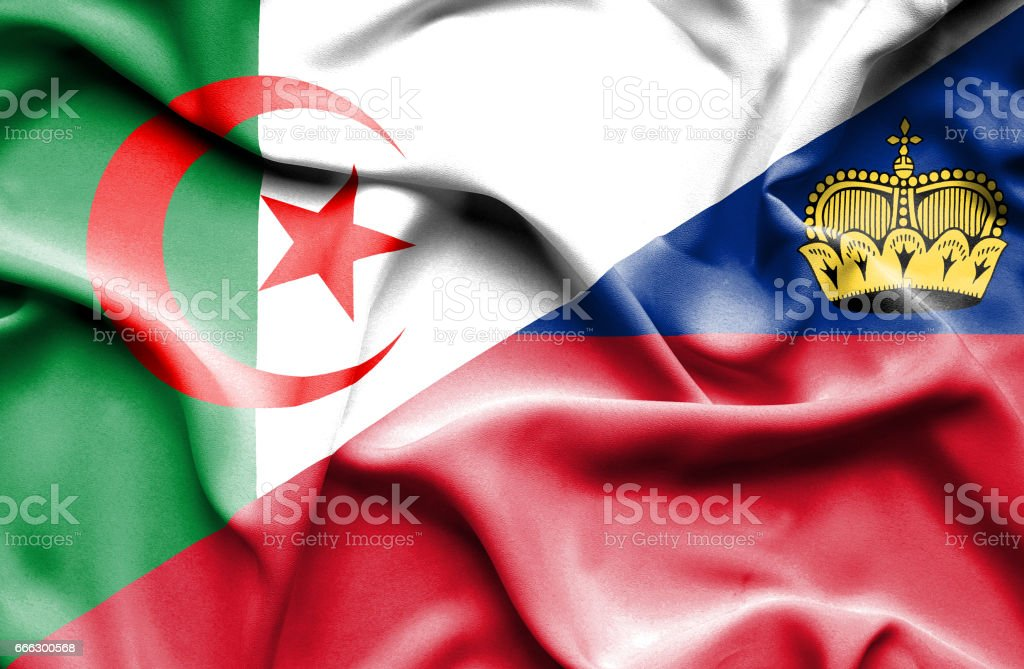 Waving flag of Lichtenstein and Algeria stock photo