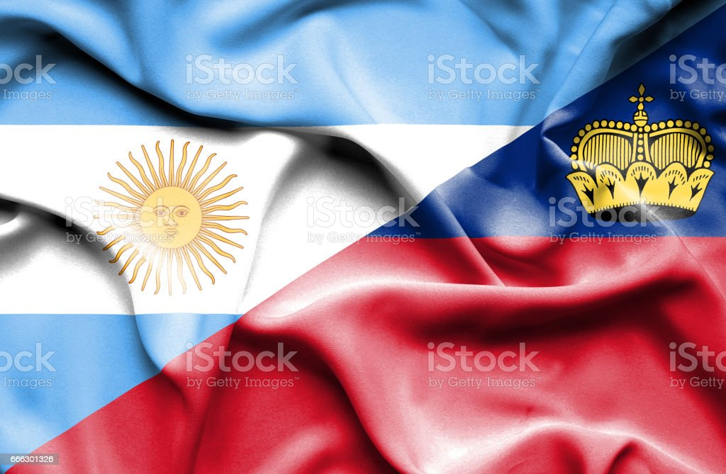 Waving flag of Lichtenstein and Argentina stock photo