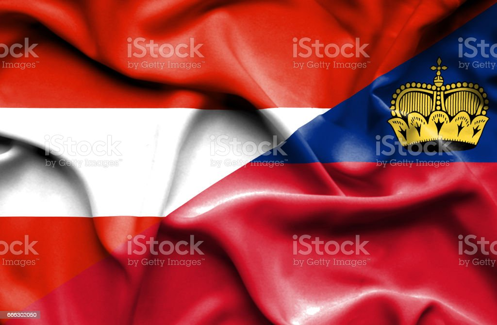 Waving flag of Lichtenstein and Austria stock photo