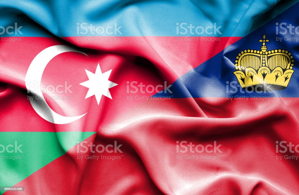 Waving flag of Lichtenstein and Azerbaijan stock photo
