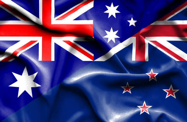 waving flag of new zealand and australia - new zealand flag stock photos and pictures