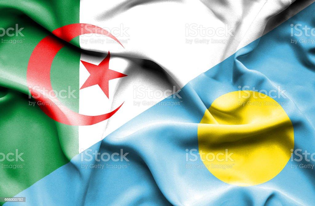 Waving flag of Palau and Algeria stock photo