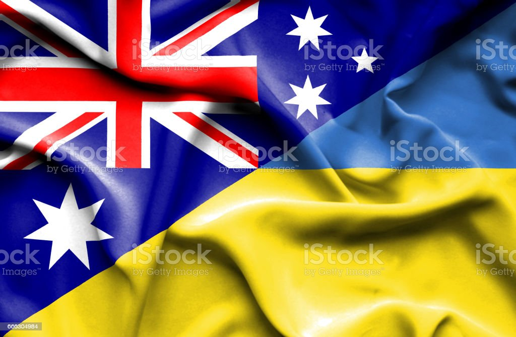 Waving flag of Ukraine and Australia stock photo