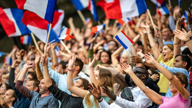 Waving French flags Crowds of French supporters waving their flags on a stadium. french culture stock pictures, royalty-free photos & images