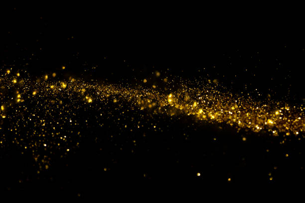 Waving golden glitter and confetti Waving golden glitter and confetti glittering stock pictures, royalty-free photos & images
