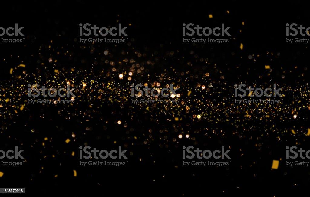 Waving golden glitter and confetti