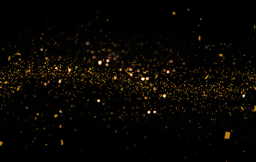 istock Waving golden glitter and confetti 813570918