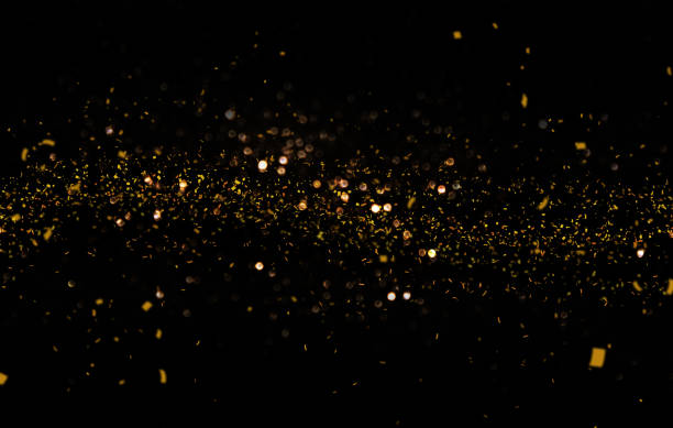 waving golden glitter and confetti - black background stock pictures, royalty-free photos & images