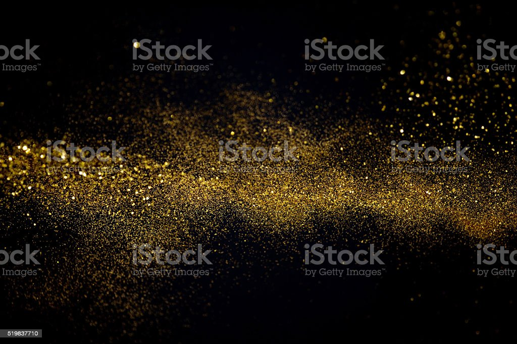 Agitando golden glitter - foto de stock