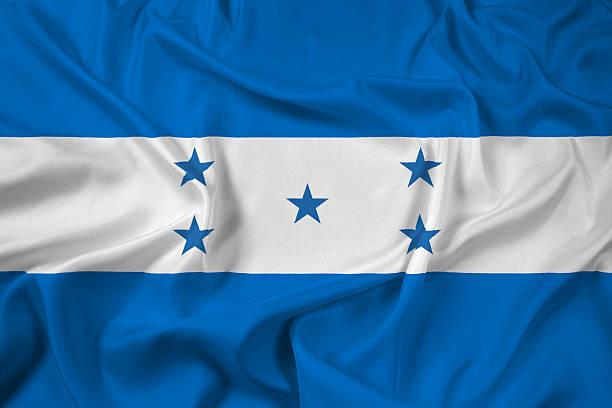 bandera agitando honduras - bandera de honduras fotografías e imágenes de stock