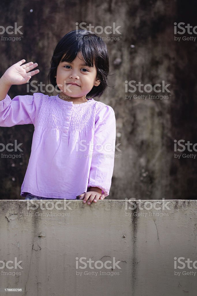 waving little asian girl stock photo