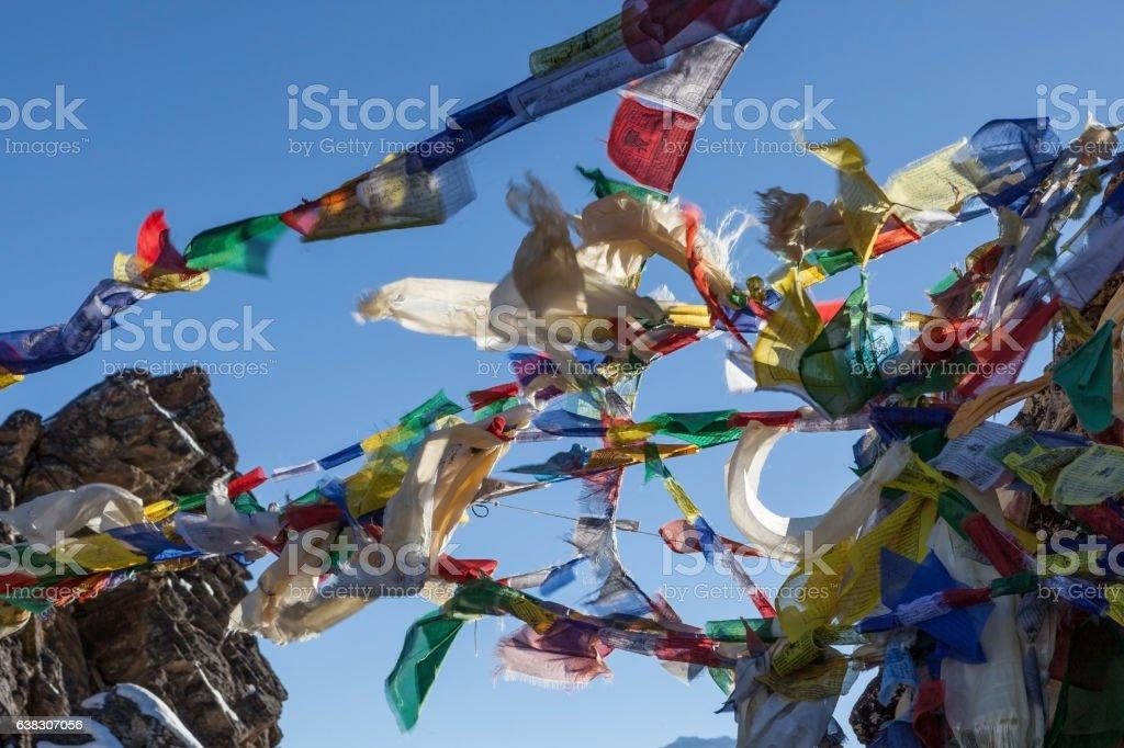 Waving multicolored Buddhist prayer flags on Renjo stock photo