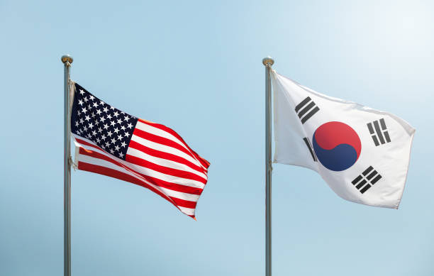 waving the American flag, the Star-Spangled Banner, the Stars and Stripes and south korean flag on blue sky, korean and us alliance, us and korean alliance waving the American flag, the Star-Spangled Banner, the Stars and Stripes and south korean flag on blue sky, korean and us alliance, us and korean alliance korean international circuit stock pictures, royalty-free photos & images
