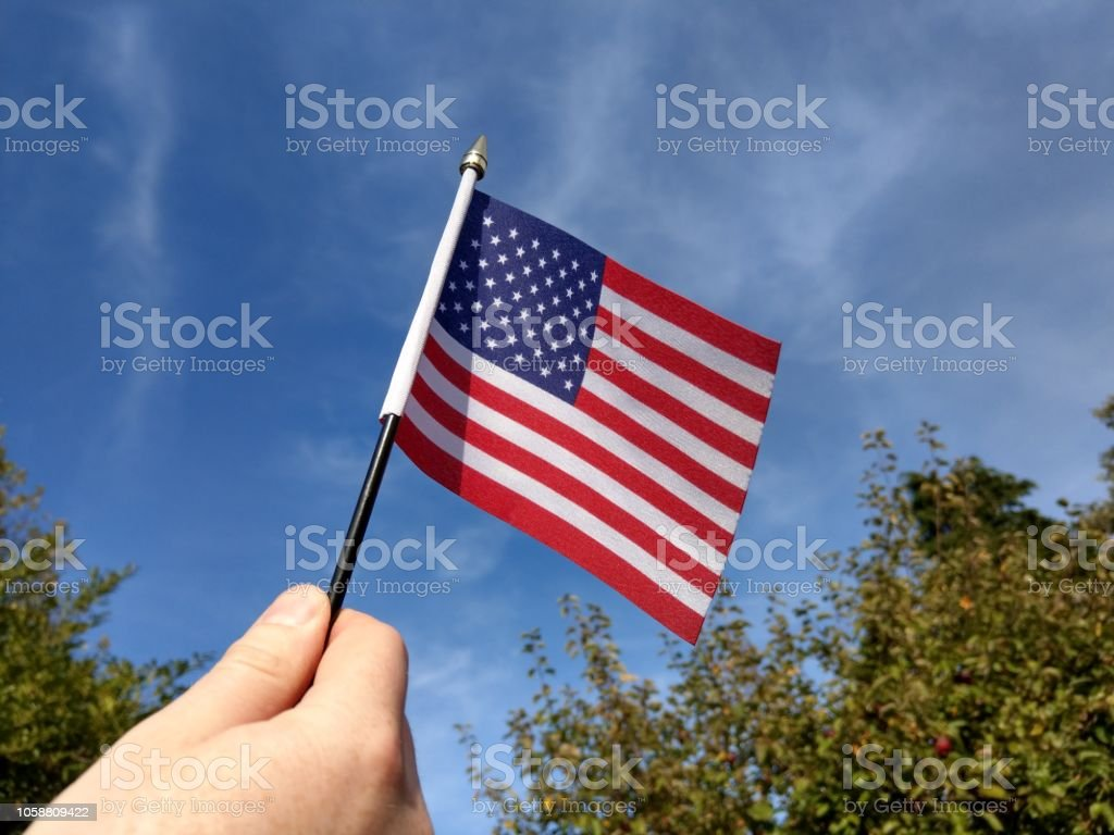Waving the US flag on a sunny day stock photo