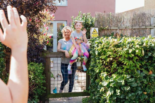 waving to the neighbor - vizinho imagens e fotografias de stock