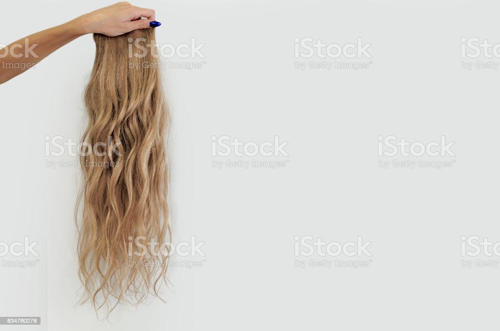 wavy blonde wig stock photo