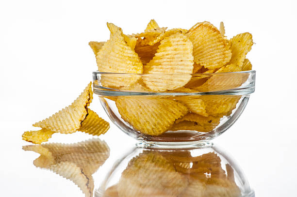 Wavy chips in a bowl stock photo