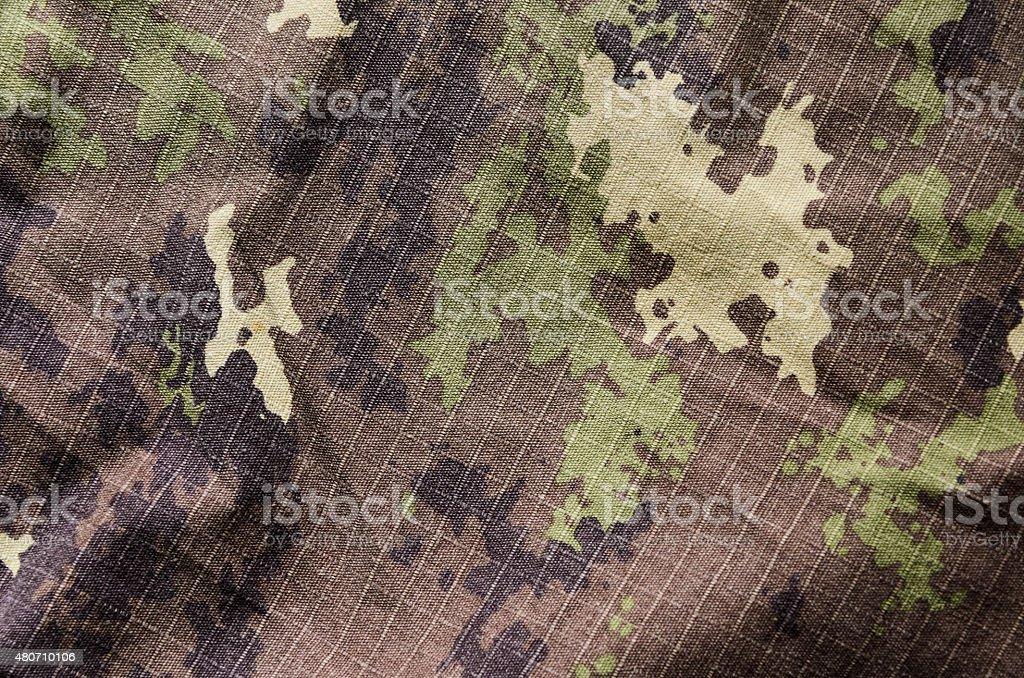 Wavy Military vegetato camouflage rip-stop fabric texture background stock photo