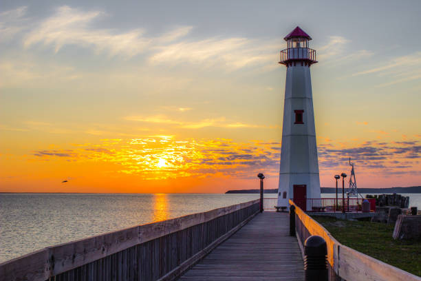Wawatam Lighthouse In St Ignace Michigan At Sunrise stock photo