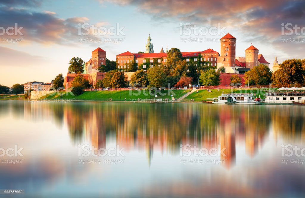 Wawel hill with castle in pink light of sunset, Krakow, Poland stock photo
