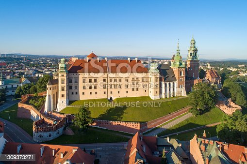 Krakow, Poland - July 1, 2020: Skyline with historic royal Wawel cathedral and castle. Aerial view in sunrise light early in the morning in summer