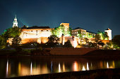 night view of Wawel Royal Castle, Cathedral and Vistula (Wisla) River in Cracow (Krakow) - UNESCO World Heritage Site. Each year Krakow hosting over 7 million tourists from all over the world.