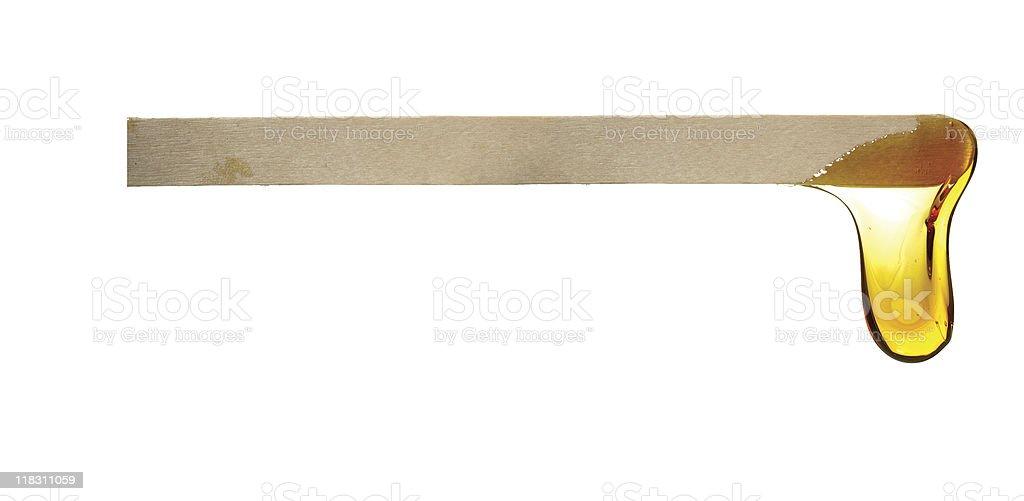 wax drop off wooden spatula stock photo