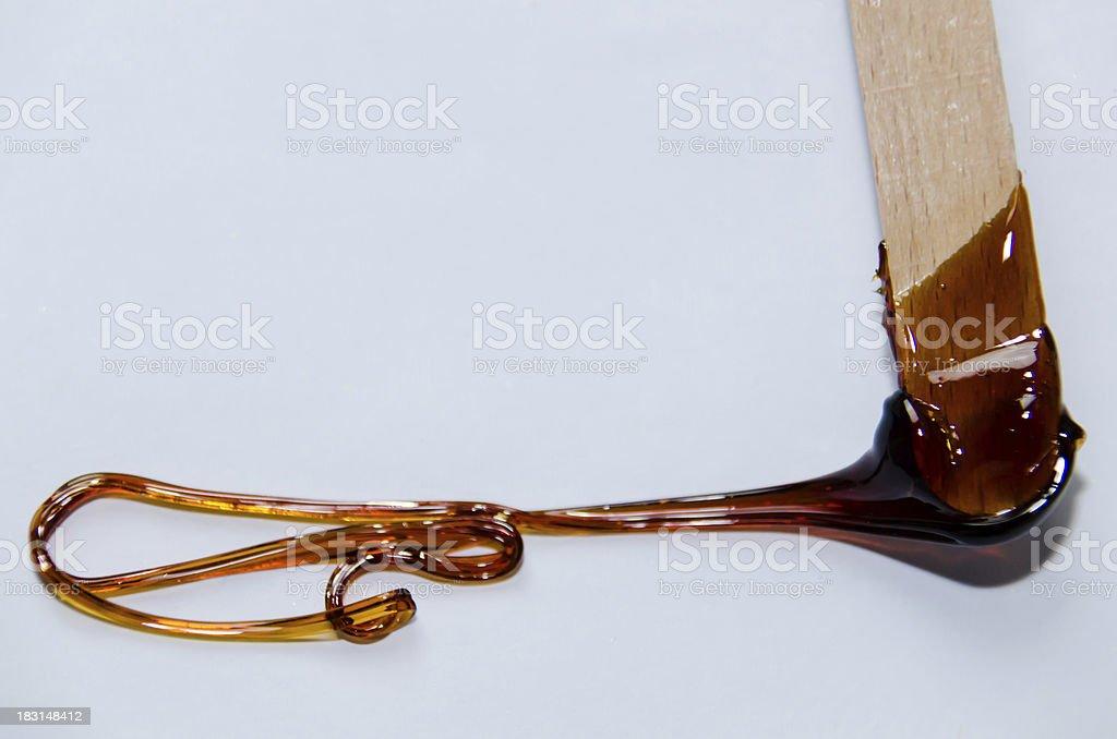 Wax on  a spatula stock photo