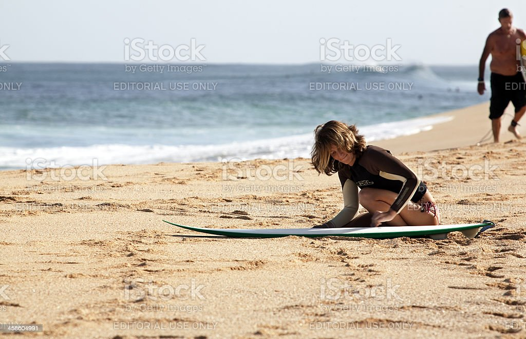 Waxing A Surfboard royalty-free stock photo