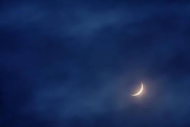 waxing crescent moon on sky stock photo