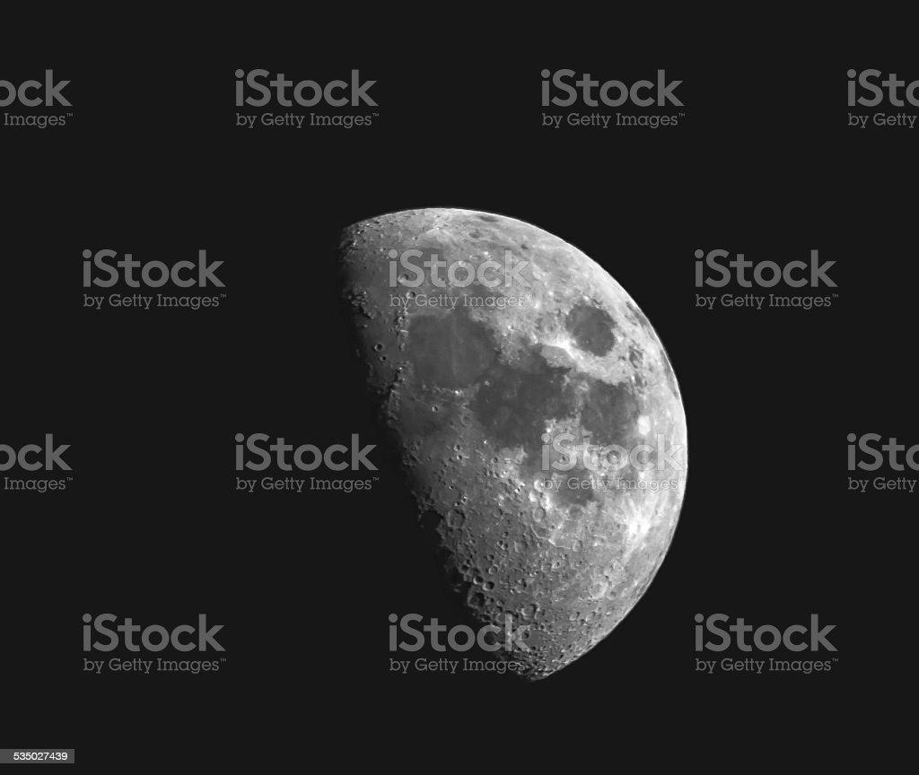 Waxing Gibbous Moon in Dark Night Sky stock photo