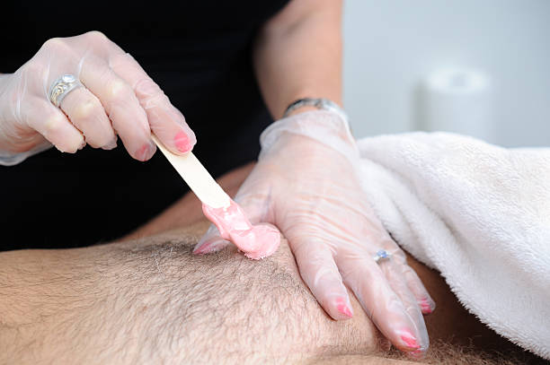 Waxing Male Pubic Hair Waxing a mans genital area. reproductive organ stock pictures, royalty-free photos & images
