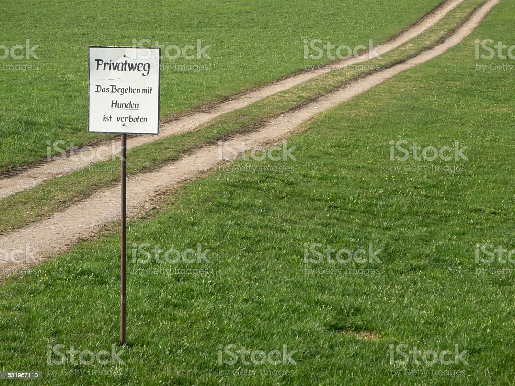 Way across a pasture with shield stock photo
