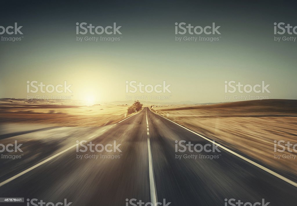 Way forward in motion. Empty road at sunset. stock photo