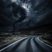 Asphalt road at storm. Forward direction.