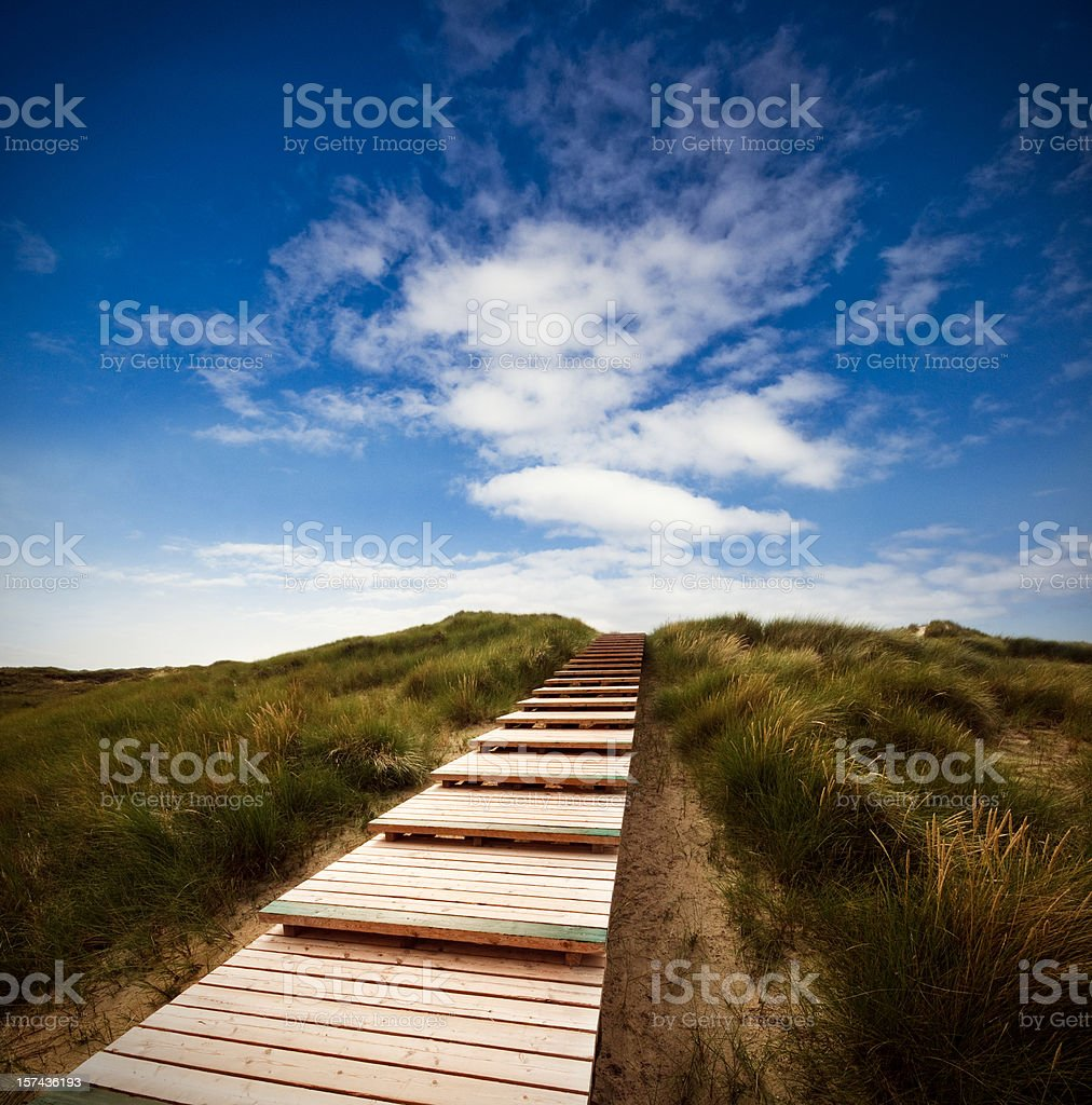 Way through the dunes with a huge sky royalty-free stock photo