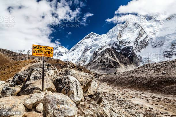 Photo of Way to Mount Everest Base Camp signpost in Himalayas, Nepal. Khumbu glacier and valley snow on mountain peaks, beautiful view landscape