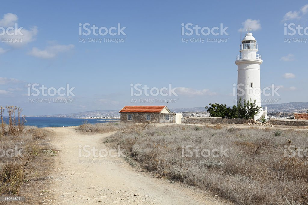 way to Paphos white lighthouse in archaeological site Cyprus royalty-free stock photo
