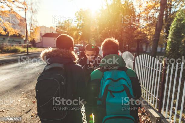 Way To School Two Angry Teenage Boys Stock Photo - Download Image Now