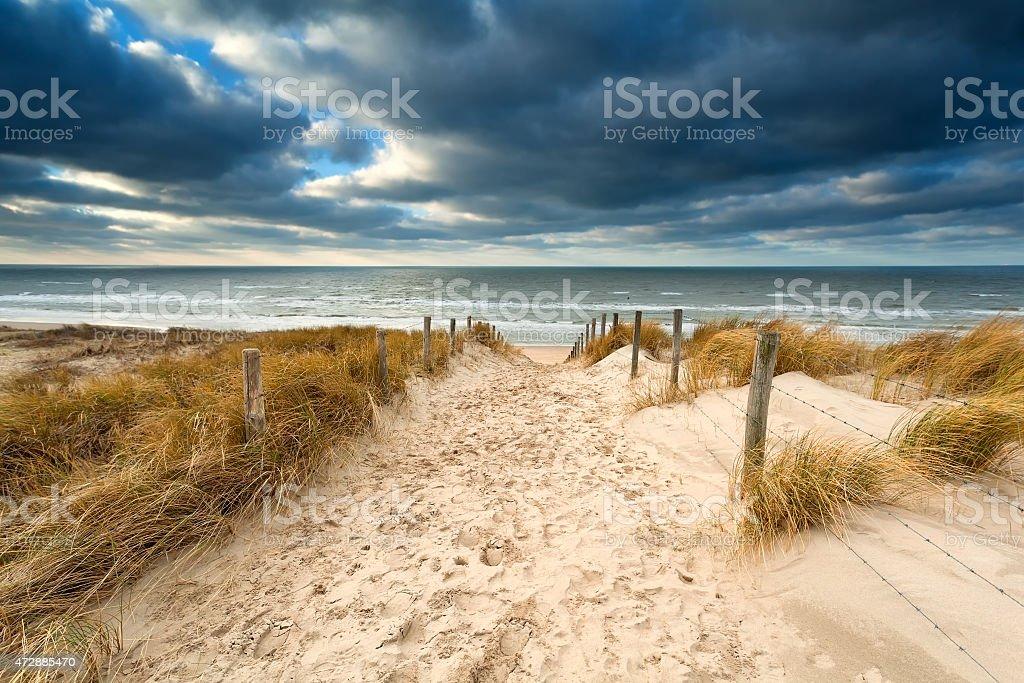 way to stormy North sea beach stock photo