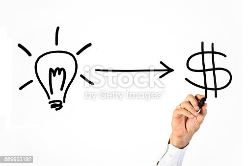 Unrecognizable male Caucasian writing on whiteboard a lightbulb and currency simbols (idea/business concept).