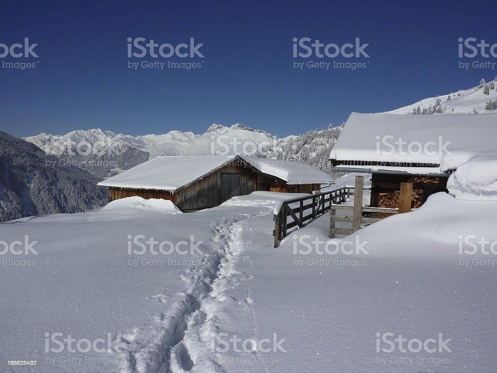 Way to the snowy mountain village royalty-free stock photo